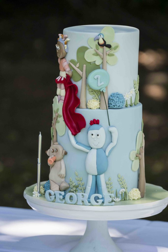 George is one lucky 2 year old. His favourite bed time book comes to life in cake form. <br> <br> Sitting down with George's mum Helen we knew this cake was going to be fun. Page by page we literally sat down and began to read the story which is; In the night garden.<br> <br> We took all the fun characters and elements George enjoyed from the book and made them come to life in the form of sugar. Interacting with each other in a playful manner.
